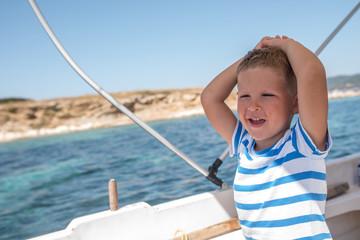 Portrait of caucasian child boy on jacht