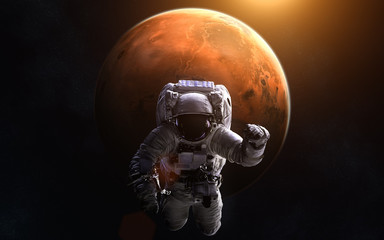 Astronaut on background of Mars. Image in 5K resolution for desktop wallpaper. Elements of the image are furnished by NASA