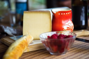 Cheese, bread, raspberry and red jug.