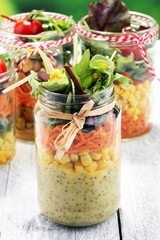 Homemade salad in glass jar with vegetables. Healthy food, diet, detox and clean eating