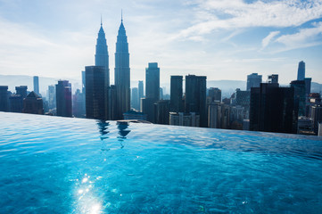 Swimming pool on the rooftop of hotel with beautiful city view. Kuala Lumpur.