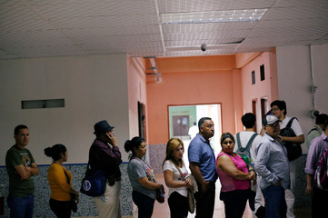 People stand in line to receive vaccination for influenza A H1N1 at a hospital in Tegucigalpa