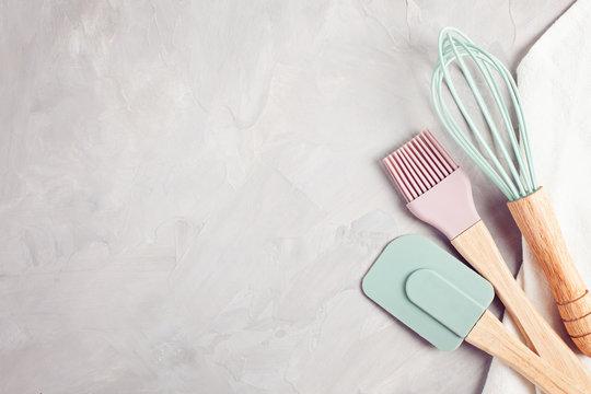 Pastel color kitchen utensils top view.