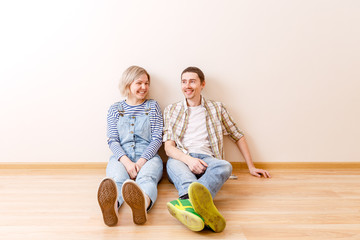 Photo of man and woman sitting on floor