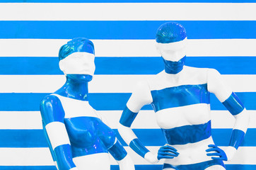 Art mannequin red and white stripes, on striped with blue and white stripes. Disguise.