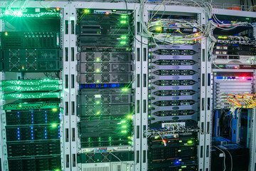 Many equipment is installed in the server room of the data center. The central technical site of the Internet provider. The main router is in the rack.