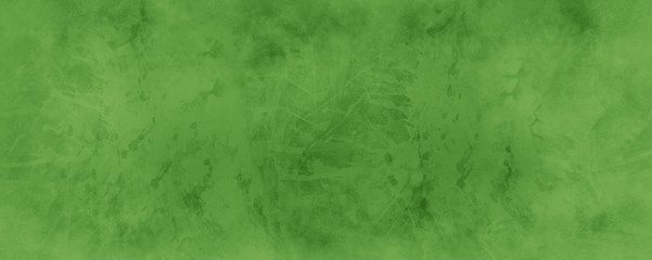 Old green background with distressed vintage marbled texture in Christmas green color.