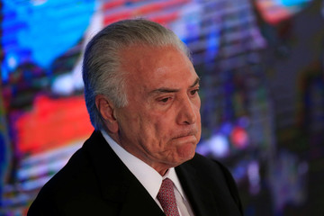 Brazil's President Michel Temer reacts during a ceremony celebrating two years in government, in Brasilia