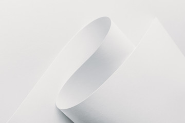 Close-up view of white rolled paper on white background