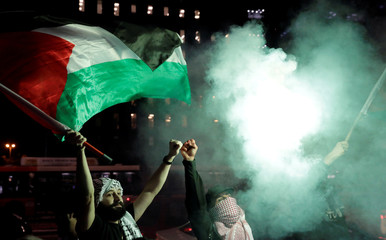 People of Palestinian descent attend a demonstration against the recent killings of Palestinian protesters on the Gaza-Israel border and the U.S. embassy move to Jerusalem, at Paulista Avenue in Sao Paulo