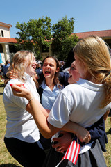 Students at Meghan Markle's former Los Angeles high school dance as they stage a 'Here's to Meghan!' celebration ahead of her marriage to Prince Harry, as they celebrate at Immaculate Heart High School in Los Angeles