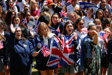 Students and teachers at Meghan Markle's former Los Angeles high school stage a 'Here's to Meghan!' celebration ahead of her marriage to Prince Harry, as they celebrate at Immaculate Heart High School in Los Angeles,
