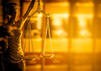 Legal law concept image, Scales of Justice, golden light.