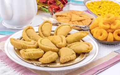 Gujiya or Gujia is a indian sweet dumpling made with suji, Maida or wheat flour and stuffed with khoya. It is common in North India, particularly in Bihar, Uttar Pradesh, Madhya Pradesh or Rajasthan