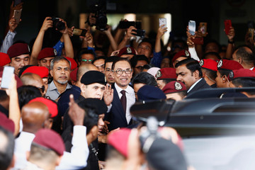 Malaysian politician Anwar Ibrahim leaves a hospital where he is receiving treatment, ahead of an audience with Malaysia's King Sultan Muhammad V, in Kuala Lumpur