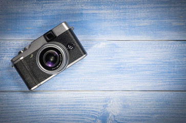 Top view camera on blue wood table background