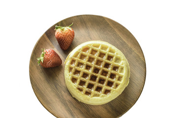 Waffles with syrup and fruit