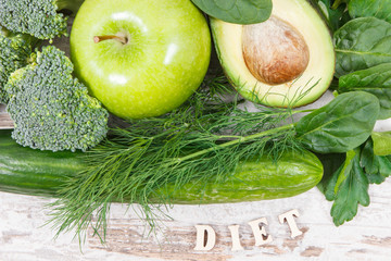 Inscription diet with fruits and vegetables containing natural minerals, vitamins and fiber, healthy nutrition concept