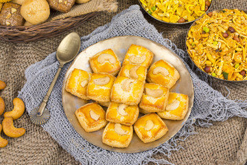 Special Freshly Sweet Cashew Nut Cookies or Biscuits Served in Plate Also Know as in India Nan Khatai, Kaju Cookies or Kaju Biscuits on Vintage Background