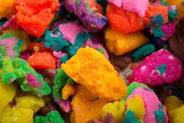 Dry colorful play dough in pieces