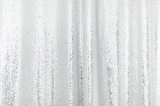 Silver sequins pattern texture fashion background. Horizontal close-up shot.