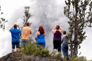 Ash erupts from the Halemaumau crater near the community of Volcano