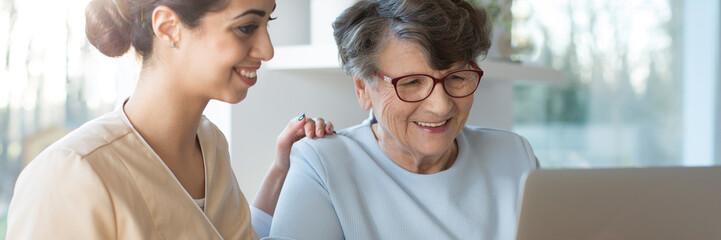 Volunteer and happy senior woman