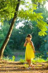 The baby girl in a bright yellow dress