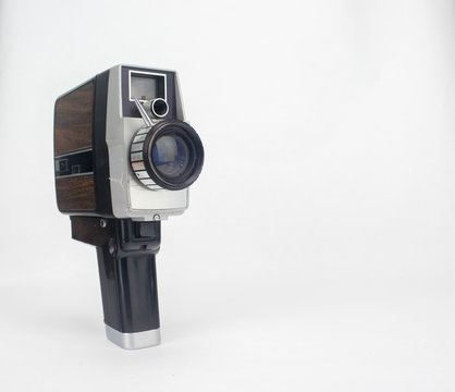 Vintage video camera on isolated bright white background