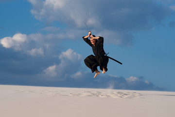 Fierce samurai on the cloudy sky background.