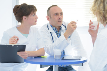 doctors and nurse relaxing sitting at the office