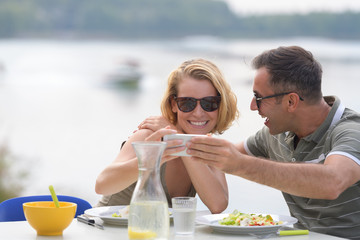 couple taking during lunch outdoors