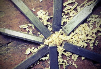 steel blades many chisels and sawdust chippings  with vintage effect