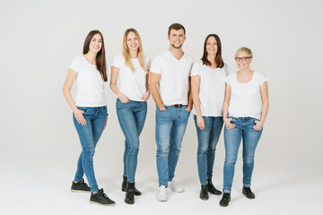 Casual relaxed group of five friends in blue jeans