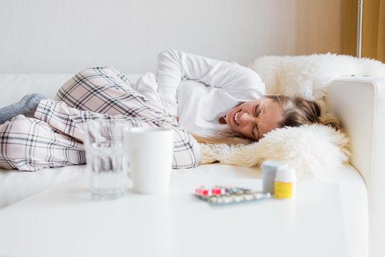 Woman having stomach cramps