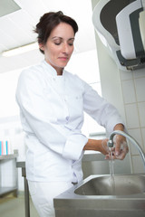 woman chef cleaning her hands