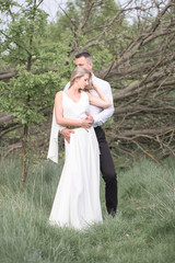beautiful love people, newlyweds, a young couple, outdoor session. The bride in a white dress. Love, wedding and passion