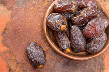 Traditional Middle East dessert, healthy food, big medjool dates fruits.