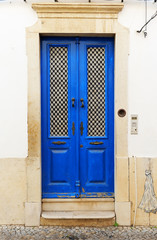 Blue door of a house in Faro, Algarve, South of Portugal