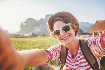 Young girl take selfie from hands with phone on summer . Travel life concept.