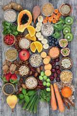 Healthy high fibre super food with fruit, vegetables, pulses, nuts, seeds, cereals and grain with foods high in antioxidants, anthocyanins, omega 3 fatty acids and vitamins. Top view.