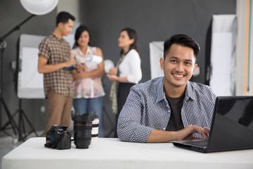 smiling people photographer in studio
