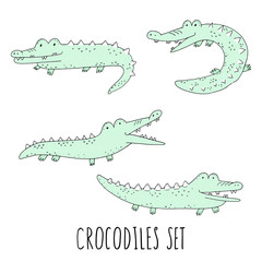 Vector set with fun crocodiles. Cartoon smiling alligators isolated on white background