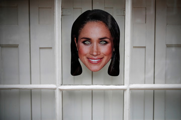 A Meghan Markle mask is stuck to a window ahead of her marriage to Britain's Prince Harry, in Windsor