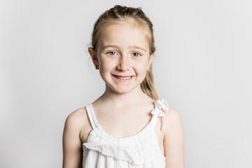 beautiful little fashion model child on white background