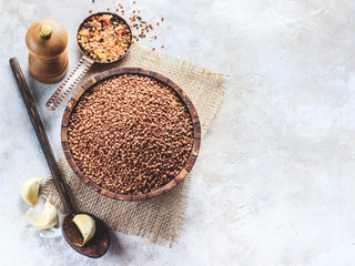 Buckwheat with spices on light background. Healthy eating