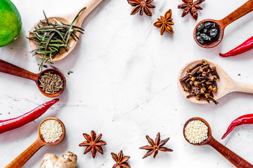 Flat lay herb and spices on white kitchen background space for t