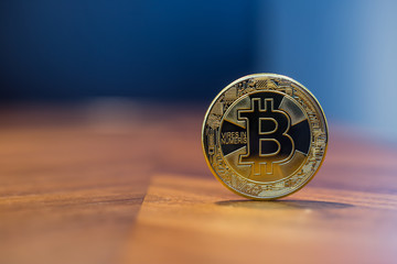 Cryptocurrency sign silver Bitcoin with blue background.