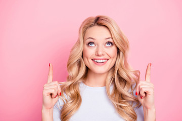 Portrait of attractive cute student nice wife positive funny girlfriend foolish freelancer carefree girl with curls beaming smile pointing two forefingers up isolated on pink background