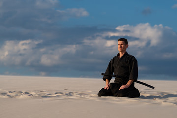 Man meditating before martial arts training